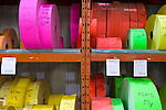 Rolls of colored paper with numbers ready for printing at a factory in Drummondville, Quebec, Canada.