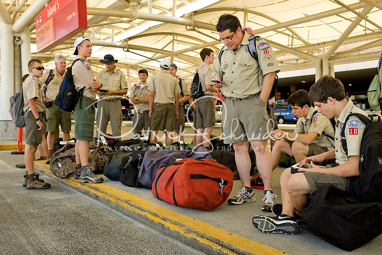 Photo story of Philmont Scout Ranch in Cimarron, New Mexico, taken during a Boy Scout Troop backpack trip in the summer of 2013. Photo is part of a comprehensive picture package which shows in-depth photography of a BSA Ventures crew on a trek. In this photo,  A Boy Scout venture crew waits on their charter bus outside the loading area at Denver International airport. The charter bus was transporting the crew to  Philmont Scout Ranch, Cimarron, New Mexico.<br /> <br /> Photo by travel photograph: PatrickschneiderPhoto.com