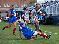 Colleen Dinn (24) of Georgetown jumps over the tackle of Rachel Pitman (8) of DePaul during the game at Shaw Field on the campus of Georgetown University in Washington, DC.  Georgetown tied DePaul, 1-1, in double overtime.