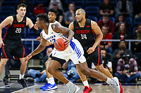 Washington, DC - March 10, 2020: Northeastern Huskies forward Connor Braun (32) dribbles the ball during the CAA championship game between Hofstra and Northeastern at  Entertainment and Sports Arena in Washington, DC.   (Photo by Elliott Brown/Media Images International)