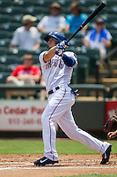 Round Rock Express shortstop Brent Lillibridge #18 follows through on his swing during the Pacific Coast League baseball game against the Memphis Redbirds on April 27, 2014 at the Dell Diamond in Round Rock, Texas. The Express defeated the Redbirds 6-2. (Andrew Woolley/Four Seam Images)