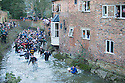 09/02/16 today photo - not as in previous incorrect caption.<br /> <br /> <br /> Players chase the ball through Henmore Brook as the Royal Shrovetide football match is played through the town of Ashbourne, Derbyshire. U'rads and Down'ards attempt to goal the ball on stone goals set three miles apart in the Peak District town.<br /> <br /> <br /> All Rights Reserved: F Stop Press Ltd. +44(0)1335 418365   +44 (0)7765 242650 www.fstoppress.com