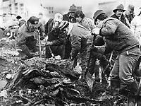 1980 FILE PHOTO - ARCHIVES -<br /> <br /> Les décombres suite a l' Incendie du Jour de l'an,1980, Chapais<br /> <br /> Grief-stricken Chapais residents help dig through debris in search for bodies. Jan 1980<br /> <br /> <br /> PHOTO : Graham Bezant - Toronto Star Archives - AQP