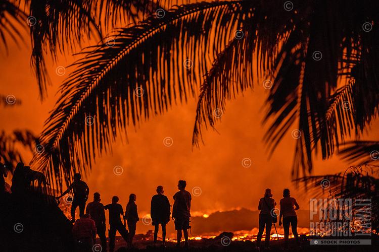 June 2018: Spectators watch a massive lava river flow through Lower Puna, Big Island of Hawai'i.
