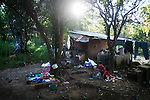 """November 08, 2014. """"Water it´s the real thing""""<br /> Raquel lives with her family in a house in Nejapa (El Salvador). Life is so difficult for her because she does'n' t have water at home. The people of Nejapa have no drinking water because the Coca -Cola company overexploited the aquifer in the area, the most important source of water in this Central American country. This means that the population has to walk for hours to get water from wells and rivers. The problem is that these rivers and wells are contaminated by discharges that makes Coca- Cola and other factories that are installed in the area. The problem can increase: Coca Cola company has expansion plans, something that communities and NGOs want to stop. To make a liter of Coca Cola are needed 2,4 liters of water. ©Calamar2/ Pedro ARMESTRE"""
