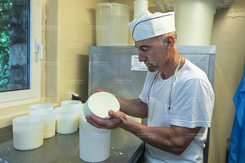 Switzerland. Canton Ticino. The family Cereghetti runs the Agriturismo Dosso dell'Ora on Monte Generoso. Franco Cereghetti is making cheese from the milk produced by the cows of his younger son Samuel. 4.07.2020 © 2020 Didier Ruef