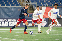 FOXBOROUGH, MA - OCTOBER 16: Justin Rennicks #12 of New England Revolution II prepares to pass as Edwin Cerrillo #33 of North Texas SC and Justin Che #46 of North Texas SC defend during a game between North Texas SC and New England Revolution II at Gillette Stadium on October 16, 2020 in Foxborough, Massachusetts.