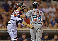 28 September 2012: Detroit Tigers third baseman Miguel Cabrera gives kudos to catcher Joe Mauer after being tagged out at the plate during a game against the Minnesota Twins at Target Field in Minneapolis, MN. The Twins defeated the Tigers 4-2 in the first game of their 3-game series. Mandatory Credit: Ed Wolfstein Photo