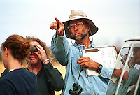 Orienteering Classroom Outdoors - Male teacher in hat talking and pointing. High School Teacher And Students. Arizona.