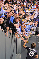 Jack McInerney (19) of the Philadelphia Union celebrates with fans after the game. The Philadelphia Union defeated D. C. United 3-2 during a Major League Soccer (MLS) match at Lincoln Financial Field in Philadelphia, PA, on April 10, 2010.