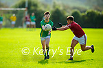 Castlegregory's Brandon Hoare about to take possession as Cromane's Cathal Crosby puts in a challenge for possession, in the Junior Football Championship Group 2 game