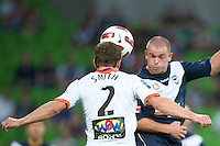 MELBOURNE, AUSTRALIA - DECEMBER 03: Matthew Smith of the Roar heads the ball during the round 17 A-League match between the Melbourne Victory and the Brisbane Roar at AAMI Park on December 3, 2010 in Melbourne, Australia. (Photo by Sydney Low / Asterisk Images)