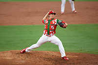 "Palm Beach Cardinals relief pitcher Ryan Helsley (26) delivers a pitch during a game against the Charlotte Stone Crabs on July 22, 2017 at Roger Dean Stadium in Palm Beach, Florida.  The Cardinals wore special ""Ugly Sweater"" jerseys for Christmas in July.  Charlotte defeated Palm Beach 5-2.  (Mike Janes/Four Seam Images)"