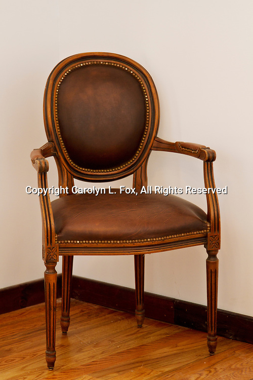 An old chair sits empty in an old historic building in Missouri.