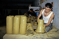 Ceramics, Nabeul, Tunisia.  Potter at Work.  Cylinders of Clay Ready for Turning on the Wheel.