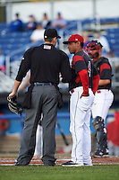 Batavia Muckdogs manager Angel Espada (4) questions a call with umpire Matt Cowan during a game against the Williamsport Crosscutters on September 2, 2016 at Dwyer Stadium in Batavia, New York.  Williamsport defeated Batavia 9-1. (Mike Janes/Four Seam Images)