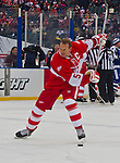 31 December 2013: Former Detroit Red Wings defenseman Nicklas Lidstrom (5) takes a slap shot during warmups before the Toronto Maple Leafs v Detroit Red Wings Alumni Showdown hockey game, at Comerica Park, in Detroit, MI.