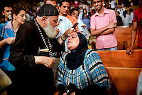 A Muslim woman with Father Samaan during an exorcism in St Simeon Church in Mokattam.<br />