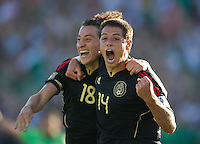 Pasadena, CA - June 25, 2011: Javier Hernandez (14) and Andres Guardado (18) celebrate Guardado's goal during the United States vs Mexico soccer match in the 2011 CONCACAF Gold Cup Championships, at the Rose Bowl. Mexico won 4-2.