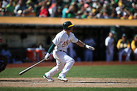 OAKLAND, CA - SEPTEMBER 24:  Nick Punto #1 of the Oakland Athletics bats against the Los Angeles Angels during the game at O.co Coliseum on Wednesday, September 24, 2014 in Oakland, California. Photo by Brad Mangin
