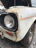 BNPS.co.uk (01202) 558833. <br /> Pic: Charterhouse/BNPS<br /> <br /> Pictured: Distinctive headlights. <br /> <br /> A clapped-out Ford Escort which has been languishing in a garage for nearly 25 years is tipped to sell for £25,000.<br /> <br /> The rare 1975 Mk 1 RS2000 model is in a rusty state and is in need of lots of care and attention.