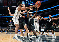 WASHINGTON, DC - JANUARY 28: Jagan Mosely #4 of Georgetown passes over Kamar Baldwin #3 of Butler during a game between Butler and Georgetown at Capital One Arena on January 28, 2020 in Washington, DC.
