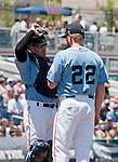 Catcher Ryan Budde talks with Aces starting pitcher Barry Enright as he struggles in the first inning during their game against the Tucson Padres game played on Sunday afternoon June 17, 2012 at Aces Ballpark in Reno, NV.