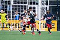 FOXBOROUGH, MA - JULY 25: Matt Polster #8 of New England Revolution defends near the New England Revolution goal during a game between CF Montreal and New England Revolution at Gillette Stadium on July 25, 2021 in Foxborough, Massachusetts.