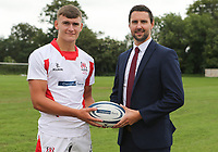 Ulster Rugby Schools 2018-2019<br /> <br /> Larne High School player Ben Moxham with Danske Bank representative Ian Russell.<br /> <br /> Photo by John Dickson / DICKSONDIGITAL