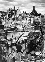 Choked with debris, a bombed water intake of the Pegnitz River no longer supplies war factories in Nuremberg, vital Reich industrial city and festival center of the Nazi party, which was captured April 20, 1945, by troops of the U.S. Army.  April 1945. (OWI)<br /> Exact Date Shot Unknown<br /> NARA FILE #:  208-AA-207L-1<br /> WAR & CONFLICT BOOK #:  1327