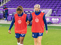ORLANDO, FL - JANUARY 22: Catarina Macario #29 and Megan Rapinoe #15 of the USWNT celebrate during a game between Colombia and USWNT at Exploria stadium on January 22, 2021 in Orlando, Florida.