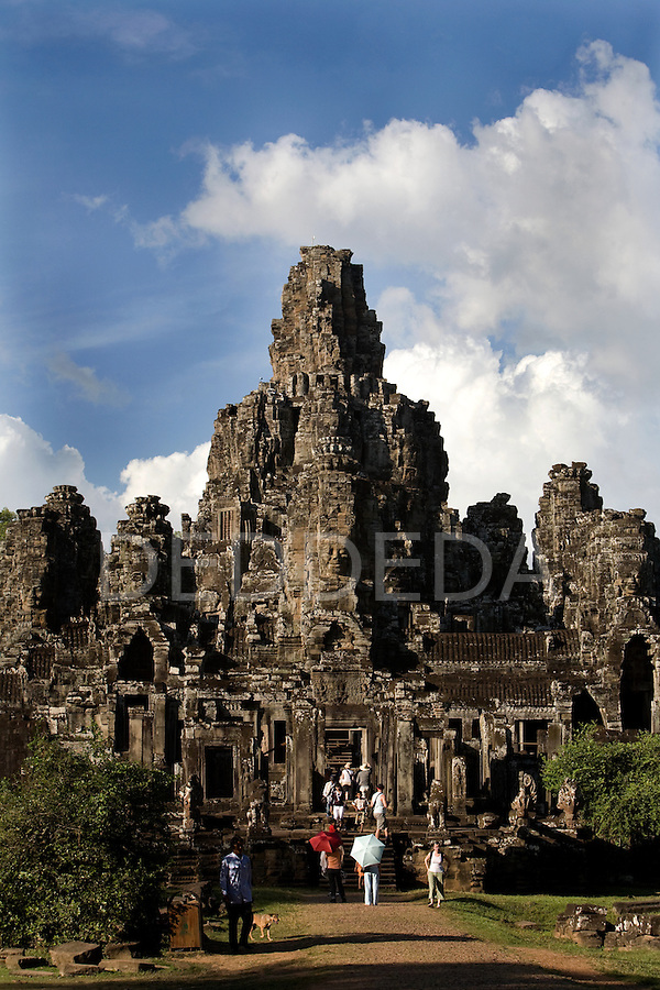 Tourists visit the Bayon Temple in the ancient city of Angkor Thom, a UNESCO World Heritage Site.