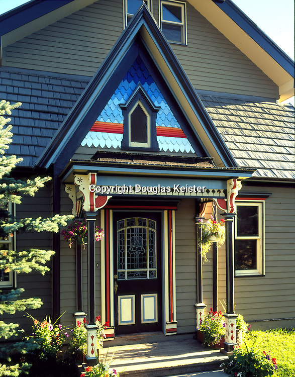 Aspen, Colorado.  1883. A striking polychromed palate of 25 colors, including blues, greens and oranges sets off the entry of this mountain Victorian in Aspen.  The body of the house remains more subdued, which accents the charm of this colorful cottage.