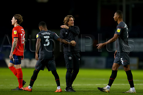 31st October 2020; Kenilworth Road, Luton, Bedfordshire, England; English Football League Championship Football, Luton Town versus Brentford; Brentford Manager Thomas Frank celebrates the 0-3 win with Rico Henry