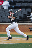 Will Craig (22) of the Wake Forest Demon Deacons follows through on his swing against the Appalachian State Mountaineers at Wake Forest Baseball Park on February 13, 2015 in Winston-Salem, North Carolina.  The Mountaineers defeated the Demon Deacons 10-1.  (Brian Westerholt/Four Seam Images)