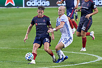 CHICAGO, UNITED STATES - AUGUST 25: Alvaro Medran #10 of Chicago Fire battles with Andrew Gutman #96 of FC Cincinnati for the ball during a game between FC Cincinnati and Chicago Fire at Soldier Field on August 25, 2020 in Chicago, Illinois.