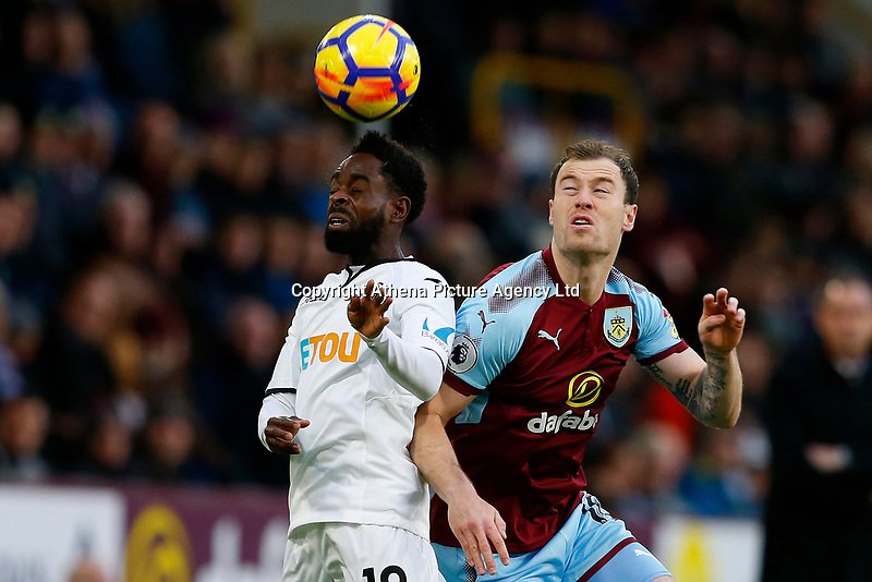 Nathan Dyer of Swansea City competes with Ashley Barnes of Burnley during the Premier League match between Burnley and Swansea City at Turf Moor, Burnley, England, UK. Saturday 18 November 2017