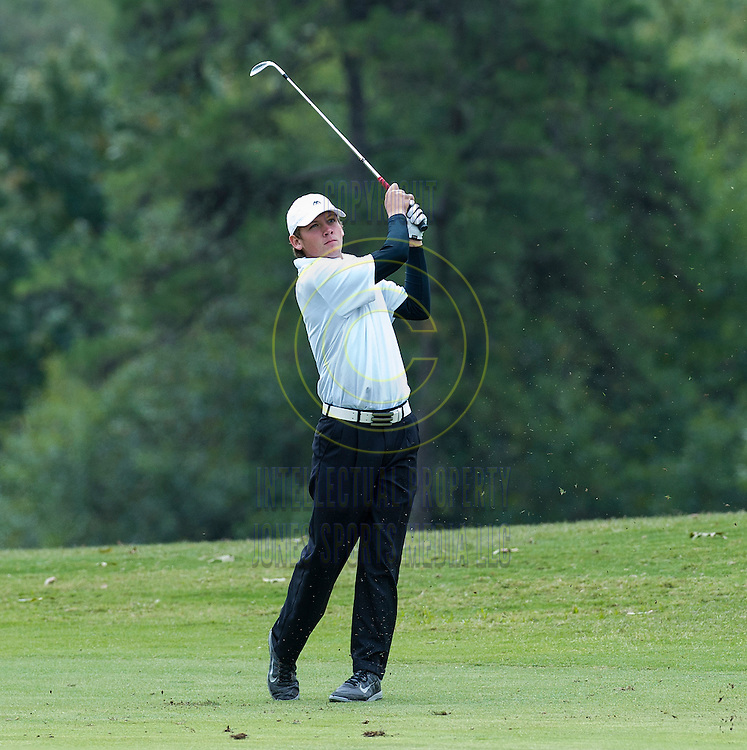 Landon Hearnes of Central Arkansas Christian fires a shot from the fairway during the Arkansas State Golf Association Boys High School  Overall Championship at Pleasant Valley Country Club Thursday morning in Little Rock. Hearnes shot a 72 to win the overall championship. ..Special to the Democrat-Gazette/JIMMY JONES