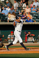 Charleston RiverDogs infielder Ty McFarland (13) at bat during a game against the Hickory Crawdads at Joseph P. Riley Jr. Ballpark on May 2, 2015 in Charleston, South Carolina. Hickory defeated Charleston  4-1. (Robert Gurganus/Four Seam Images)
