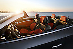 2011 Renault Megan Convertible side view on location at a beach during sunset.