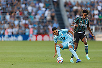 ST PAUL, MN - AUGUST 14: Emanuel Reynoso #10 of Minnesota United FC is fouled by Kevin Cabral #9 of the Los Angeles Galaxy during a game between Los Angeles Galaxy and Minnesota United FC at Allianz Field on August 14, 2021 in St Paul, Minnesota.
