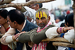 Crowds watch the procession of Sadhus (Holy Men) traveling to take holy bath in Ganges River in Allahabad for Kumbh Mela Festival..