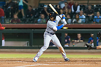 Surprise Saguaros center fielder Khalil Lee (15), of the Kansas City Royals organization, at bat during an Arizona Fall League game against the Scottsdale Scorpions at Scottsdale Stadium on October 15, 2018 in Scottsdale, Arizona. Surprise defeated Scottsdale 2-0. (Zachary Lucy/Four Seam Images)