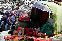 MEDELLÍN, COLOMBIA, MAY 14: An boy Venezuelan immigrants sleeps outside the bus terminal in Medellín, Colombia, on May 14, 2020. Venezuelan migrants hope to have the opportunity to take a bus to the border due to the new pandemic. . from COVID19. (Photo by Fredy Builes / VIEWpress via Getty Images)