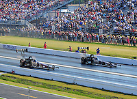 Apr. 29, 2011; Baytown, TX, USA: NHRA top fuel dragster drivers Larry Dixon (right) races alongside teammate Del Worsham during qualifying for the Spring Nationals at Royal Purple Raceway. Mandatory Credit: Mark J. Rebilas-
