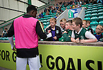 Hibernian 3 Alloa Athletic 0, 12/09/2015. Easter Road stadium, Scottish Championship. Recent signing Islam Feruz signing autographs for young home fans during the second-half at Easter Road stadium during the Scottish Championship match between Hibernian and visitors Alloa Athletic. The home team won the game by 3-0, watched by a crowd of 7,774. It was the Edinburgh club's second season in the second tier of Scottish football following their relegation from the Premiership in 2013-14. Photo by Colin McPherson.