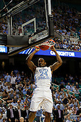 Justin Watts dunks in the second half. UNC defeated Vermont 77-58 during the 2nd round of the 2012 NCAA Basketball Championship at the Greensboro Coliseum in Greensboro, NC. Photo by Al Drago.