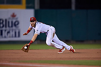 Lansing Lugnuts third baseman Johnny Aiello (4) makes a divig stop during a Midwest League game against the Burlington Bees on July 18, 2019 at Cooley Law School Stadium in Lansing, Michigan.  Lansing defeated Burlington 5-4.  (Mike Janes/Four Seam Images)