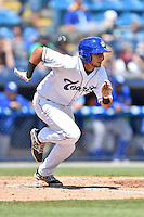 Asheville Tourists center fielder Omar Carrizales (19) runs to first during a game against the Lexington Legends on May 3, 2015 in Asheville, North Carolina. The Legends defeated the Tourists 6-3. (Tony Farlow/Four Seam Images)
