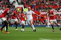 Pictured: Jonjo Shelvey of Swansea (C) against Ander Herrera. Saturday 16 August 2014<br />